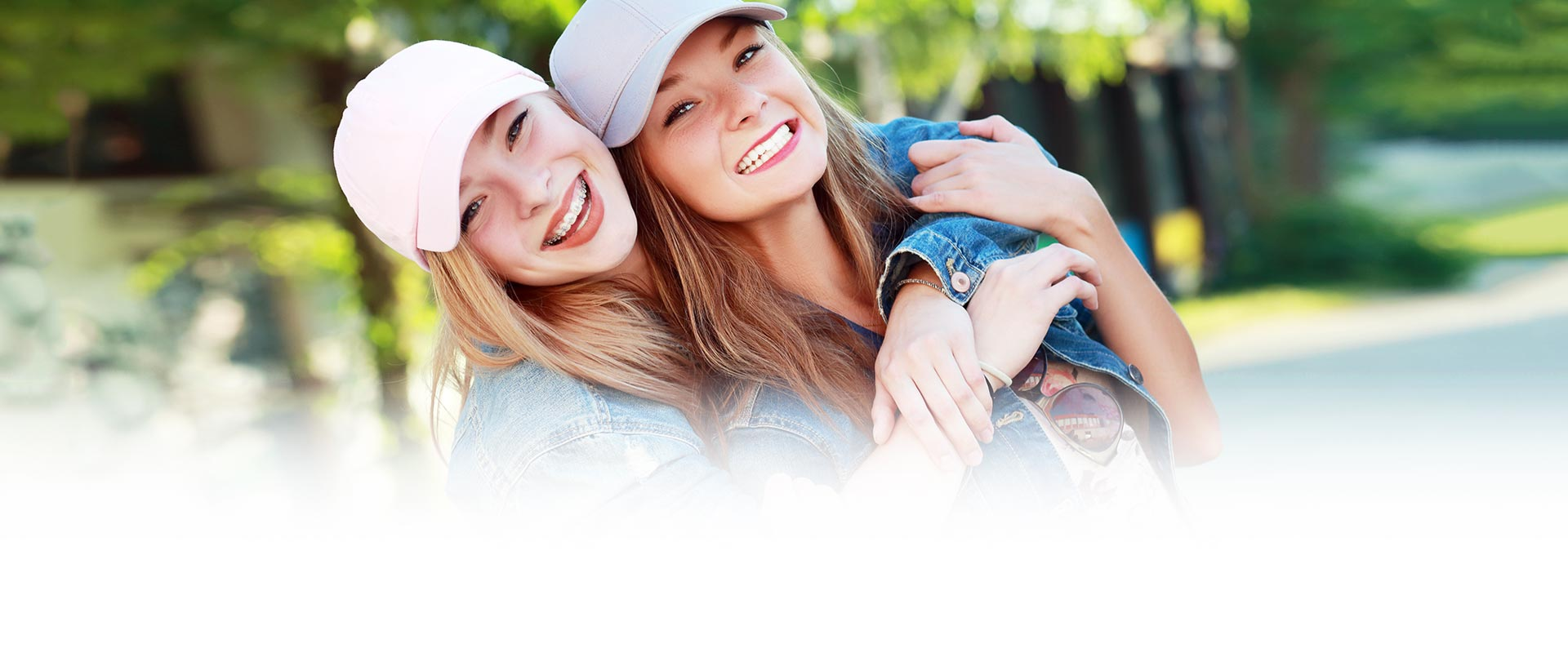 Teenage Girl Friends Braces Moss Wall Orthodontics located in Lacey WA